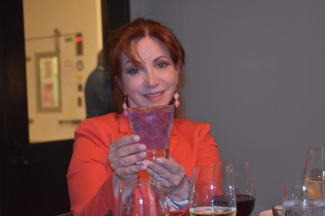 Leslie Holds Cocktail.JPG