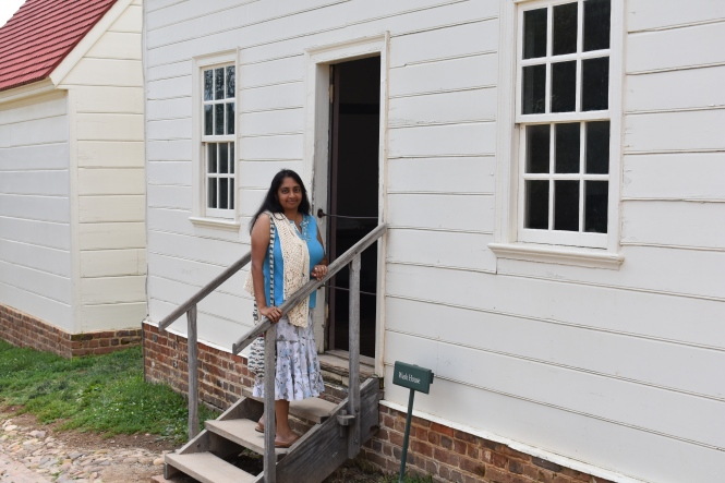Vanitha Examines an Outbuilding